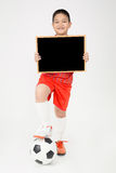 Little asian boy holding empty wood blackboard in sport unifrom Stock Photo