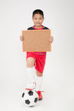 Little asian boy holding empty wood blackboard in sport unifrom Stock Images