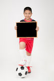 Little asian boy holding empty wood blackboard in sport unifrom Stock Photography