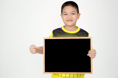 Little asian boy holding empty wood board in sport unifrom Stock Image