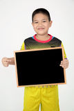Little asian boy holding empty wood board in sport unifrom Stock Photography