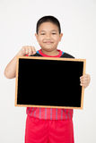 Little asian boy holding empty wood board in sport unifrom Stock Photos