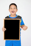 Little asian boy holding empty wood board in sport unifrom Royalty Free Stock Image