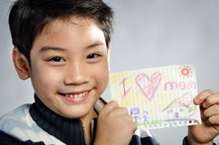 Little asian boy holding picture wiith word Stock Image