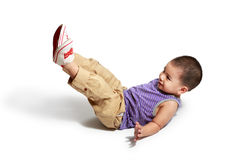 Little asian boy laying on a floor royalty free stock photography