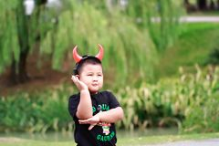 Little asian boy. Outdoor portrait of a little asian fat boy,nPlay in the park royalty free stock images
