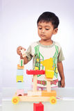 A little asian boy play toy Stock Image
