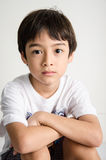 Little asian boy portrait sitting with small smile Royalty Free Stock Photo