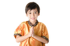 Little asian boy praying in Thai costume  isolate on white backg Royalty Free Stock Image