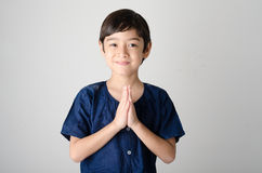 Little asian boy praying in Thai costume. Isolate on white background Stock Photo