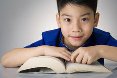 Little asian boy read a book Stock Photo