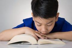Little asian boy read a book Stock Photography