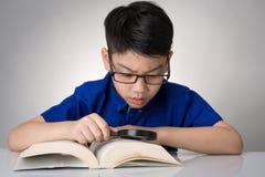 Little asian boy read a book Stock Photos