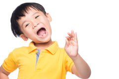 Little asian boy showing his lost milk-tooth in his hand - close Royalty Free Stock Images