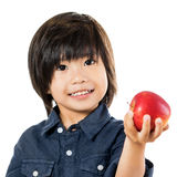 Little asian boy showing red apple. Stock Photos