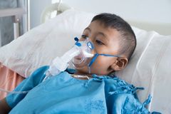 Little asian boy sick asthma royalty free stock photo