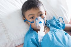 Little asian boy sick asthma royalty free stock image