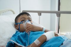 Little asian boy sick asthma stock photo