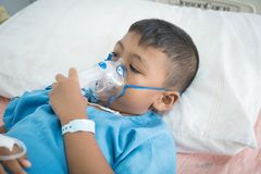 Little asian boy sick asthma stock photography