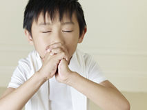 Little asian boy. Six year old little asian boy praying Stock Images