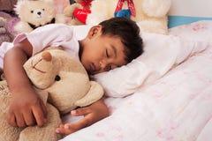 A little asian boy sleep. With teddy bear Royalty Free Stock Photos