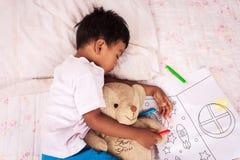 A little asian boy sleep. With teddy bear Royalty Free Stock Images