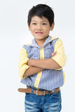 Little asian boy with smile face on gray background Stock Images