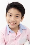Little asian boy with smile face on gray background Royalty Free Stock Photos