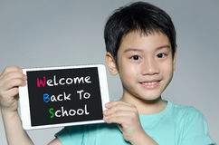 Little asian boy smiles with tablet computer  With Back to Schoo Stock Images