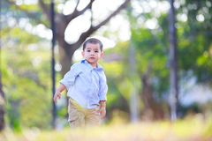Little asian boy standing in the park Stock Images