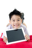 Little asian boy in student's uniform with tablet computer on is Royalty Free Stock Photos