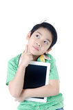 Little asian boy think about that with tablet computer on isolat Stock Photography