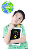 Little asian boy think about that with tablet computer on isolat Stock Photo