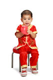 Little asian boy in traditional chinese cheongsam Royalty Free Stock Photo