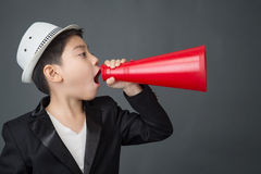 Little asian boy using megaphone shouting Royalty Free Stock Photo