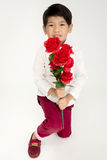Little Asian boy in vintage suit with red rose Royalty Free Stock Photos