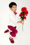 Little Asian boy in vintage suit with red rose Royalty Free Stock Photography