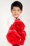 Little Asian boy in vintage suit with red rose Royalty Free Stock Image