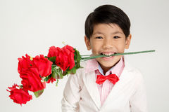Little Asian boy in vintage suit with red rose Royalty Free Stock Photo