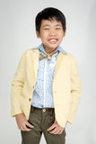 Little Asian boy in vintage suit  with smile face Royalty Free Stock Images