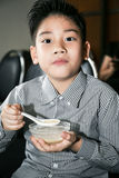Little asian child drinking cream of thai dessert Stock Images