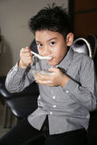 Little asian child drinking cream of thai dessert Royalty Free Stock Photos