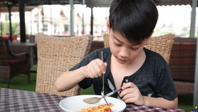 Little asian child eating pizza at restaurant . stock video footage