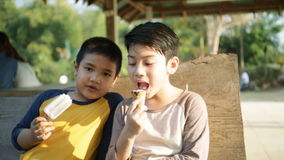 Little asian child enjoy eating an ice cream.  stock video footage