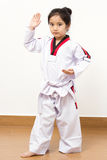 Little asian child in fighting action Royalty Free Stock Image