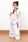 Little asian child in fighting action Royalty Free Stock Photography