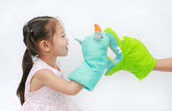 Little Asian child girl hands playing animal puppets with hand of her mother on white background. Educations concept royalty free stock photography