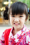 Little asian child in japanese traditional costume. Little asian cute child in japanese traditional costume, kimono Royalty Free Stock Photos