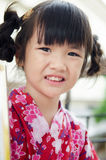 Little asian child in japanese traditional costume. Kimono Royalty Free Stock Photos