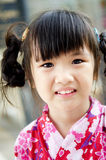 Little asian child in japanese traditional costume. Portrait of Little asian child in japanese traditional costume, kimono Royalty Free Stock Images